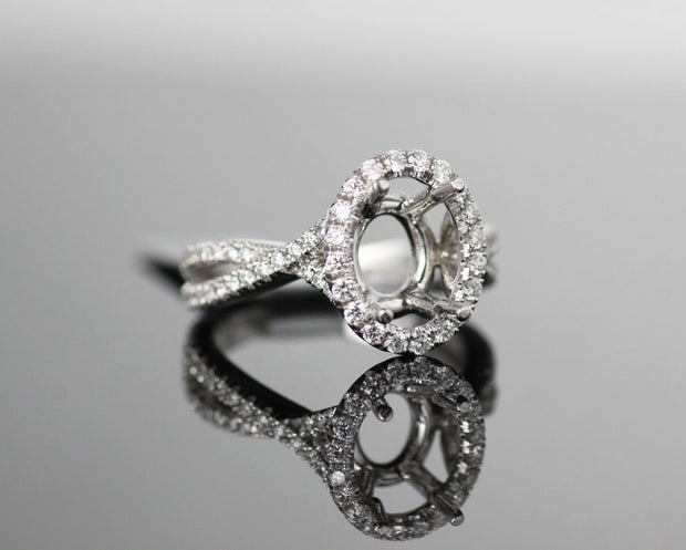 Oval Halo with Intertwined Shank Setting