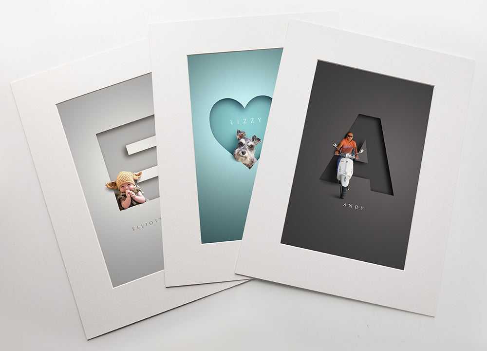 three premuim quality prints inside white photo mounts. cute baby in a knitted hat, a schnauzer dog inside a heart shape and a man on a scooter coming out of the letter A