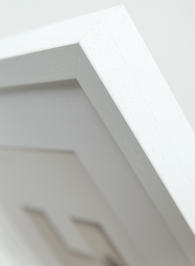 white wooden picture frame corner detail