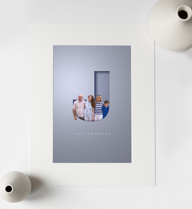 Unusual graphic design of family portrait photo added to a cut out letter effect that gives a 3D look and family name in an elegant typeface written underneath