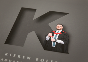 close up of digital composite of male graduate designed to look like he is standing inside the initial letter of his name