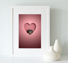 Load image into Gallery viewer, black and tan dachshund dog looking out of a heart shape cut out on a pink background and framed in a white wooden picture rame