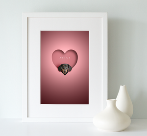 black and tan dachshund dog looking out of a heart shape cut out on a pink background and framed in a white wooden picture rame