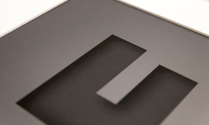 close up image showing the texture and quality of the dark grey design with the cut out effect of the capital letter F