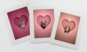 set of 3 pictures in shades of pinks and in white photo mounts. Each one is a head shot of a tabby cat, black frenchie and sad looking Beagle sitting inside a heart shape looking out at the viewer