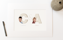 Load image into Gallery viewer, picture in photo mount of two children, each one sitting inside the initial letter of their name and their full name written below in a classy serif font