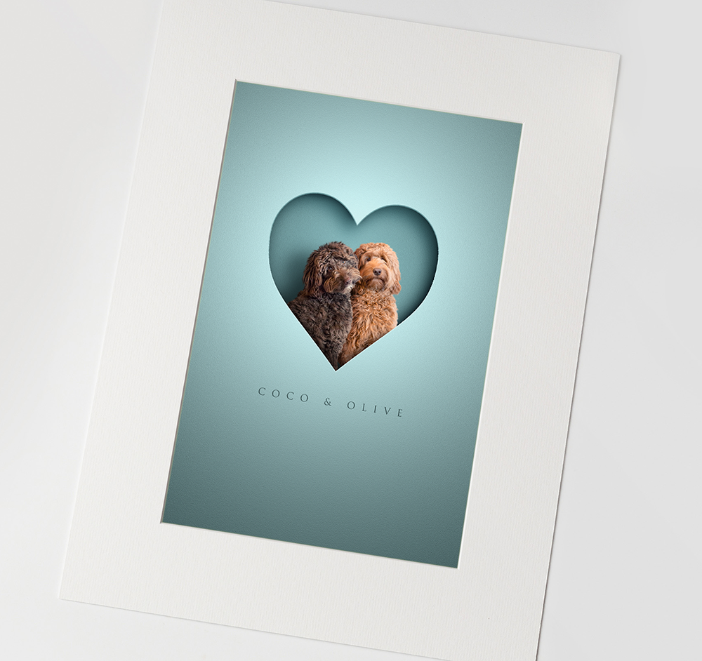 High quality graphic design of 2 shaggy dogs inside a heart with a 3D effect and their names in elegant font underneath