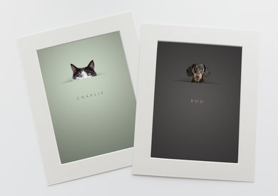 2 pictures in white photo mounts of pets peeking above a horizon line and their names are written below in a serif font