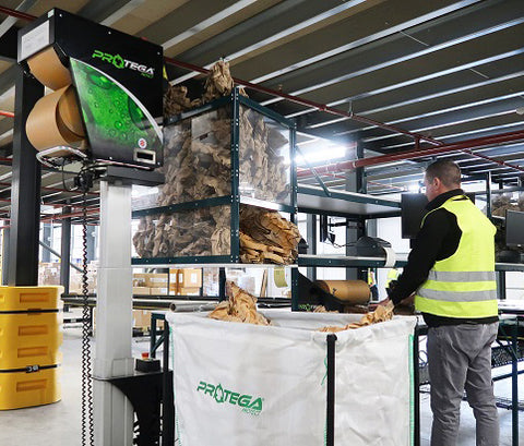 Protega paper cushioning system integrated into a packing line