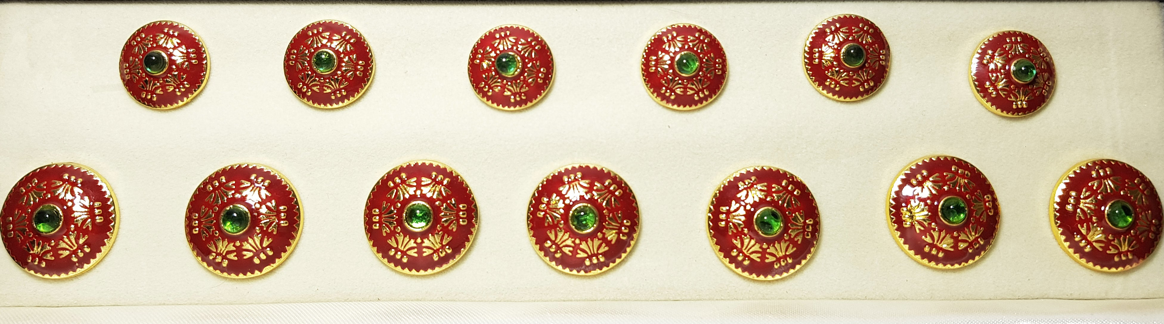 Maroon Rayons Button with Green Stone