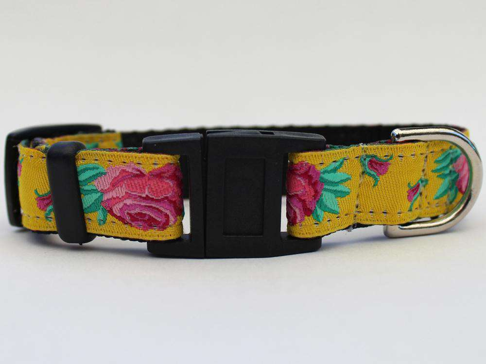This is the Spanish Rose Design Breakaway Buckle Cat Collar by Surf Cat.   It has a red rose set against the brilliant yellow of a Sevilla Sun. It has  breakaway buckles that pop open under eight pounds of pressure. It is made of comfortable and lasting nylon overlaid with durable polyester ribbon. The quintuple stitching at specific stress points adds strength. The fabrics and stitching of the collar actively responds to your cat's actions helping the collar retain its pliable design.