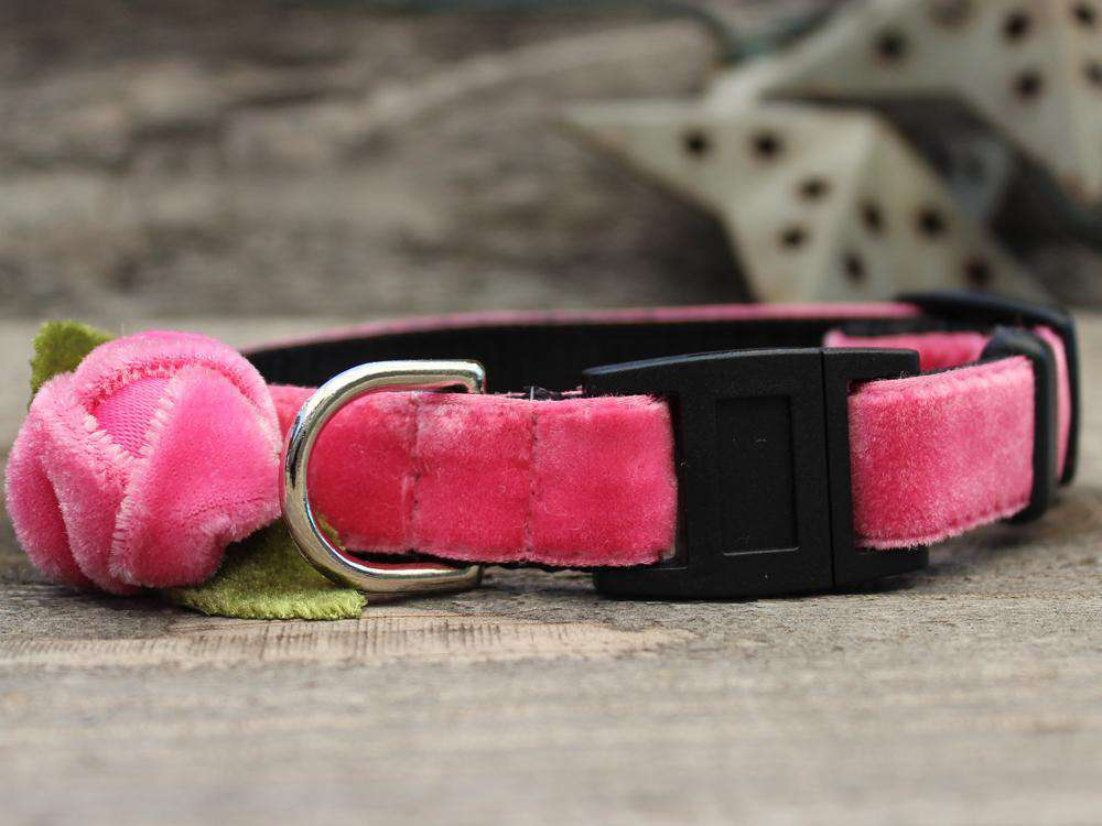 This is the Rosebud Pink Velvet Breakaway Buckle Cat Collar. It is a cat collar with a pink velvet rose on it, which the rose does come in red too. The rose has two small green fabric leaves too. The collar has breakaway buckles that pop open with eight pounds of pull. It is made of soft and comfortable nylon overlaid with durable polyester ribbon. It is quintuple stitched at stress points for added strength.