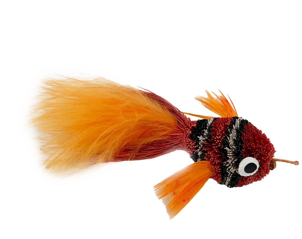 This is a Pretty Fly Clownfish Teaser Wand Cat Toy Replacement Lure by Catboutique. It is burnt orange-red. The fish has black and white stripes. There is a feather tail. The lure is made of deer hair and is dyed a dye that isn't harmful to cats. This lure is meant to engage at the cat's hunting instincts like prowling, pawing, and pouncing.