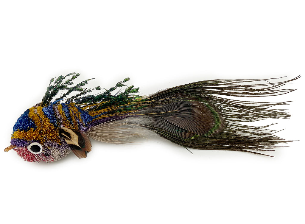 This is a Pretty Fly Fish Teaser Wand Cat Toy Replacement Lure by Catboutique. The fish is made from deer hair, and it has a peacock eye feather for a tail. The fish has feathers for fins and dorsal fin. There is a ringlet where the fish's mouth should be. The fish is turquoise, gold, purple, and pink. This lure is meant to engage at the cat's hunting instincts like prowling, pawing, and pouncing.