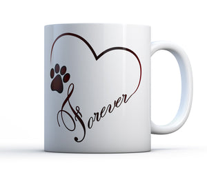 Best gift for dog lovers. A sentimental and unique ceramic mug with artwork of a paw print, a heart and the word forever.
