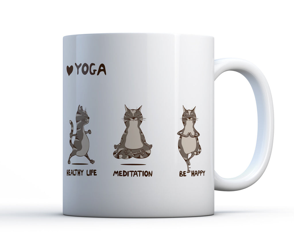 White ceramic coffee cup with 3 cats performing yoga poses with the words yoga, healthy life, meditate and be happy.
