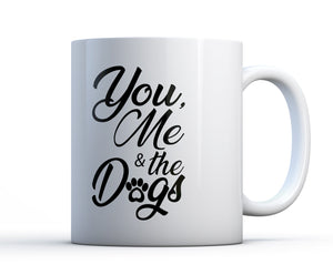 "11oz or 15oz ceramic coffee mug with pawprint and the words ""You, Me and The Dogs""."