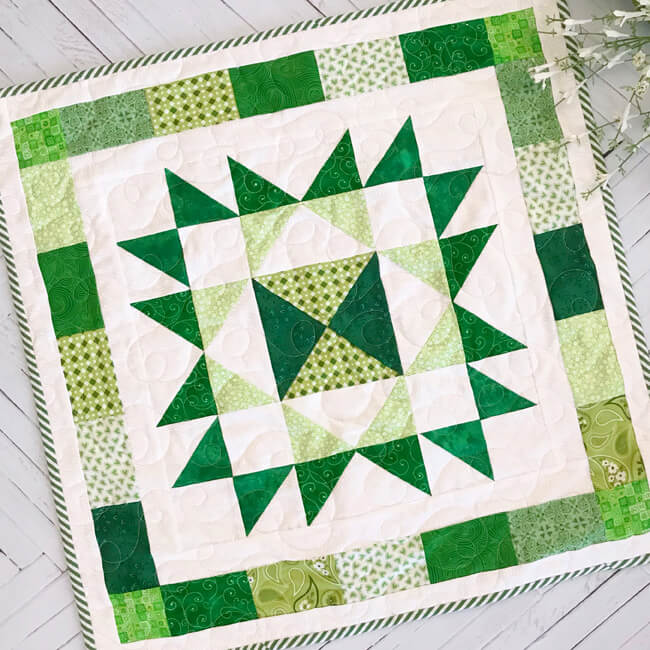 """Scrappy Star Table Topper"" Free Pattern designed by Lindsey Weight from Fort Worth Fabric Studio"