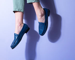 Blue Italian leather loafers with leather sole on model