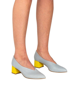 Italian leather deep V cut pump with low block heel in sky blue with lemon heel on model