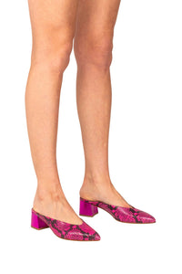 Italian leather  hot pink snakeskin mule with low block heel in metallic hot pink on model