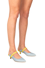 Italian leather mule in sky blue and lemon two tone with kitten heel on model