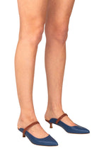 Italian leather mule in navy and chocolate two tone with kitten heel on model