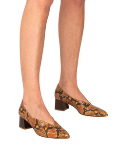 Italian leather deep V cut pump with low block heel in brown snakeskin with metallic brown heel on model