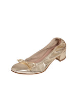 Metallic platinum gold low heeled ballet flat with elastic edging and bow detail