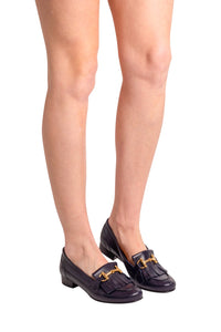 Navy Italian leather loafers with fringe and gold buckle detail on model