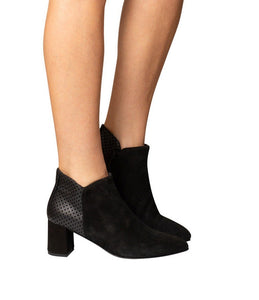Black Italian suede heeled ankle boot with pointed toe and suede dot detail on heel block on model