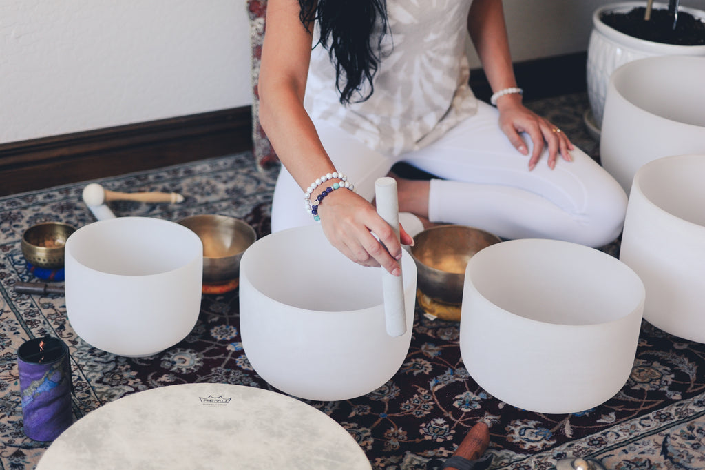 Cleansing crystal jewelry with crystal singing bowls