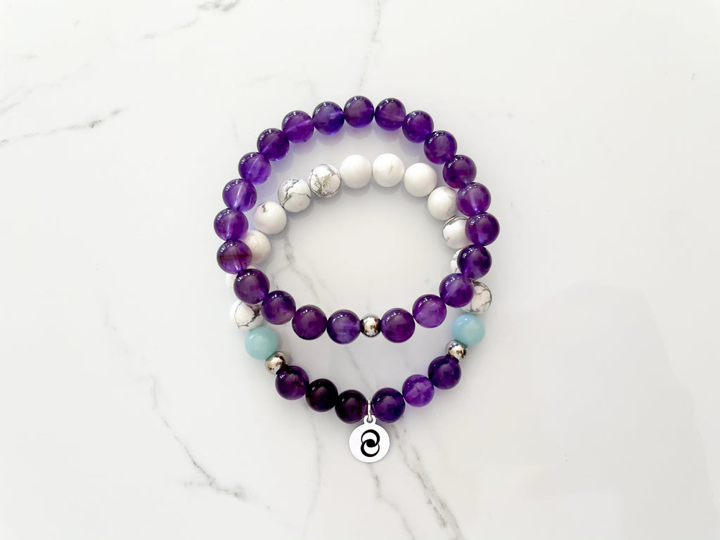Healing crystal bracelet stack hand-made with amethyst, howlite, and amazonite.