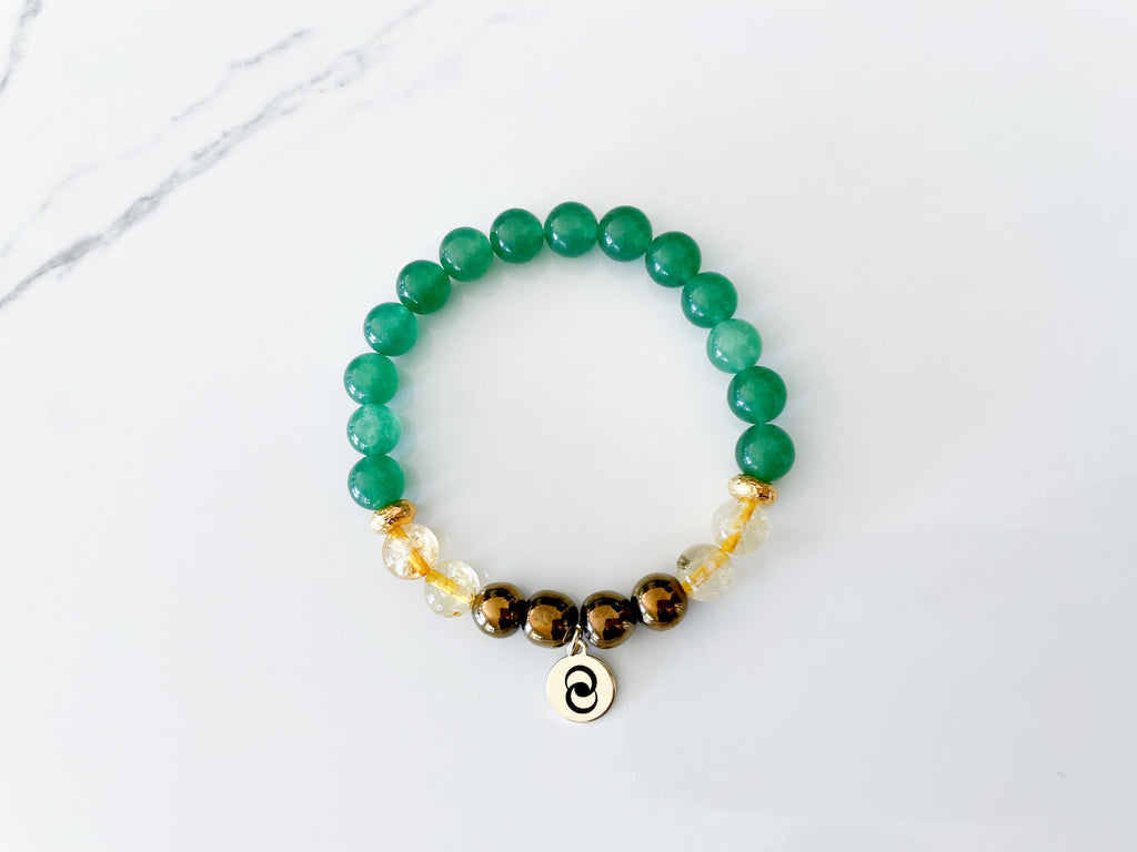 Healing crystal stretch bracelet for manifesting money made with green aventurine, pyrite, and citrine crystals.