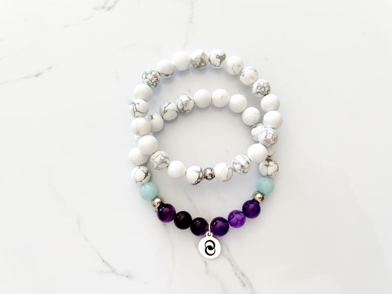 Manifest health and wellbeing with this healing crystal bracelet made with amethyst, howlite, amazonite
