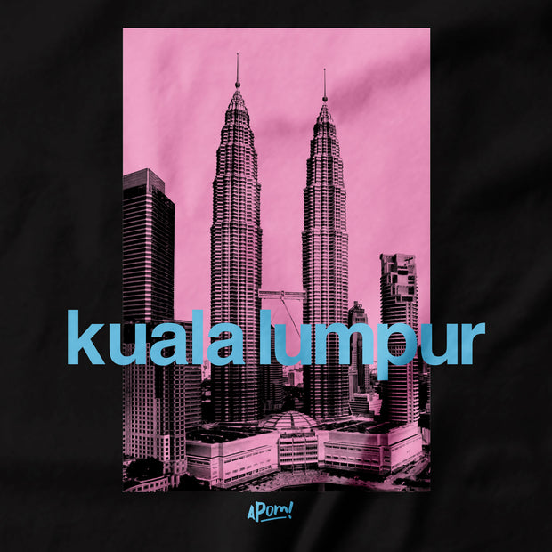 The Petronas Twin Towers once stood as the tallest towers in the world. Stand tall with this KLCC street tee. If you want to bring home a piece of Malaysia this is a must have souvenir. Close Up of the silkscreen print. Pink on black. Of malaysia's tallest building! By Apom!