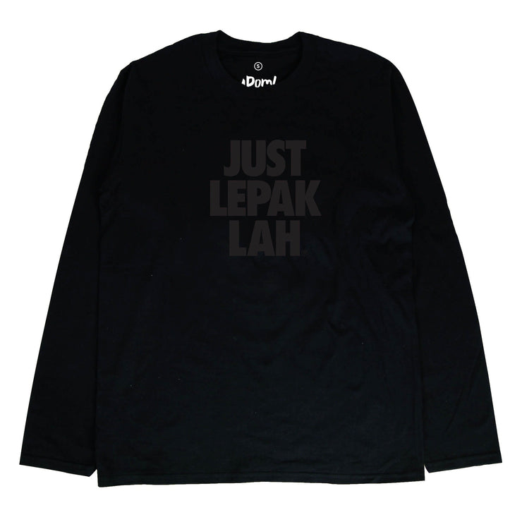 "This black cotton long sleeved-T, has black words printed on it with the words Just Lepak Lah. One part serious street-ware, one part tongue in cheek Malaysian humor so often associated with Apom.my. While the world and Nike might say 'Just Do It. Malaysia's favorite Malaysian Brand, Apom says: ""Just Lepak Lah"" (Just Relax). This masterpiece is part of Apom's, Mamak performance wear, designed to keep you comfortable for those long mamak sessions"
