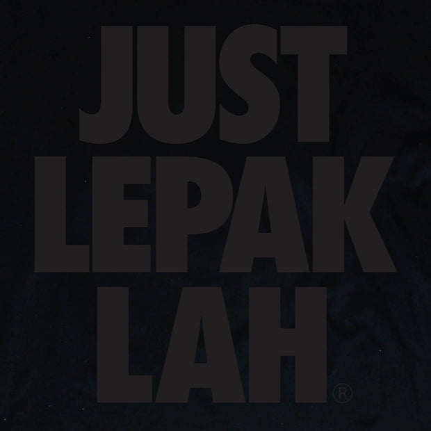 Close up of the Just Lepak Lah Graphic. This black cotton long sleeved-T, has black words printed on it with the words Just Lepak Lah. One part serious street-ware, one part tongue in cheek Malaysian humor so often associated with Apom.my.  part of Apom's, Mamak performance wear, designed to keep you comfortable for those long mamak sessions