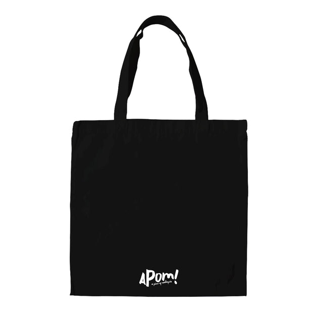 "On the back of this ""Cha bagi the ais satu""  tote bag reads the APOM brand Logo in striking white against the black fabric material."