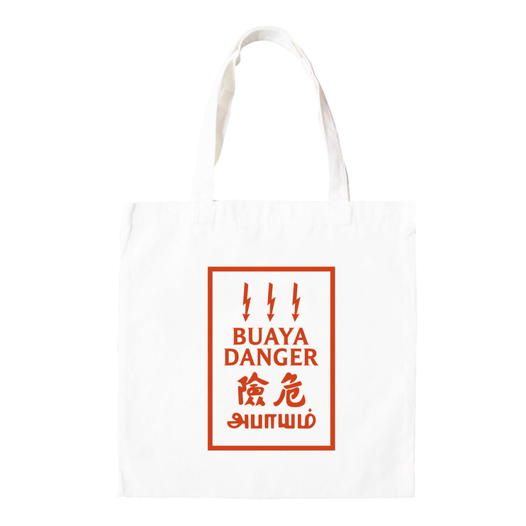 "In this Totebag Design a typical Malaysian 'warning high voltage sign' Is replaced with the words. ""Buaya Danger"" . The urban dictionary definition of Buaya is - Bua•ya When a boy sees girls, his heart leaps excitedly like a thousand undecided tadpoles and so he pursues every single girl he meets. Sometimes also called, gatal. A suitable statement for a ladies man who know's he'a all that. It also makes for an awesome street fashion statement and travel gift or souvenir"