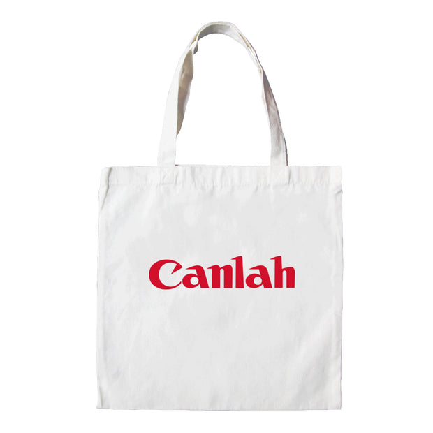 The Canon logo is replaced with the local plan 'Canlah' in this Malaysia parody. The Apom tote bag is a popular travel souvenir and street fashion statement. It represents the tongue in cheek can do mentality of Malaysia.