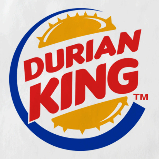 "A close up of This White tote bag is emblazon with the Burger King Logo which upon further inspection reads. ""Durian King."" It is the perfect Malaysian souvenir and even a street fashion statement. Featuring Apom's trademark tongue in cheek humour and The king of all fruits; the durian!"