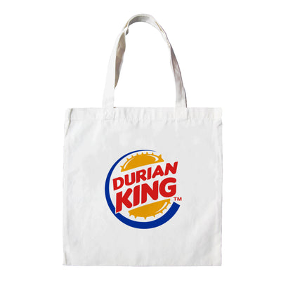 "This White tote bag is emblazon with the Burger King Logo which upon further inspection reads. ""Durian King."" It is the perfect Malaysian souvenir and even a street fashion statement. Capturing Apom's trademark tongue in cheek humour and arguably Malaysia's most love it or hate it icon. The king of all fruits; the durian!"