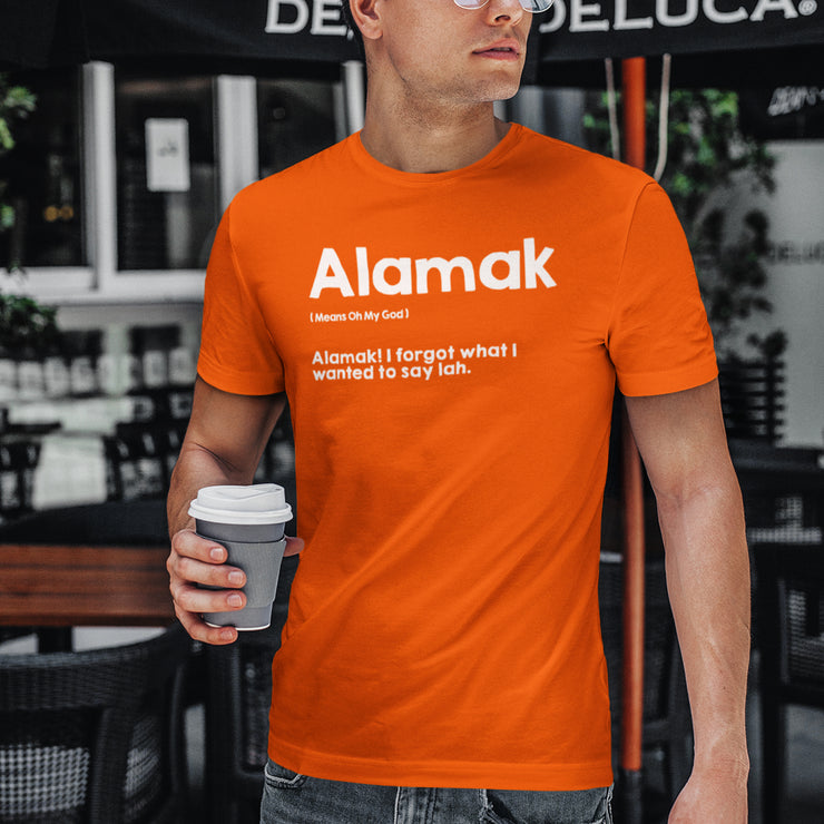 Man wears an Orange T-Shirt, Apom explains the meaning of the local slang 'Alamak' as well as gives an example of it's meaning.