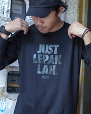 Male: This black cotton long sleeved-T, has black words printed on it with the words Just Lepak Lah. One part serious street-ware, one part tongue in cheek Malaysian humor so often associated with Apom.my.  part of Apom's, Mamak performance wear, designed to keep you comfortable for those long mamak sessions