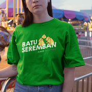 An attractive young Malaysian wearing apom's Batu Seremban Design