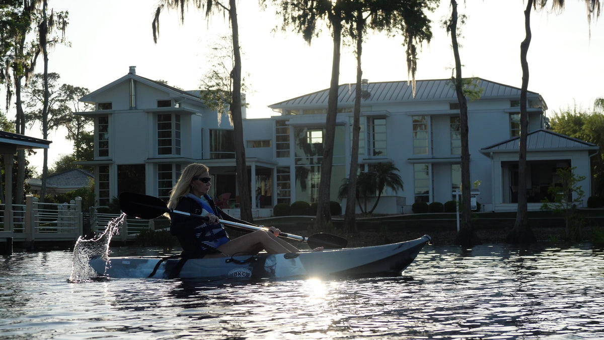 woman on a sit-on-top kayak