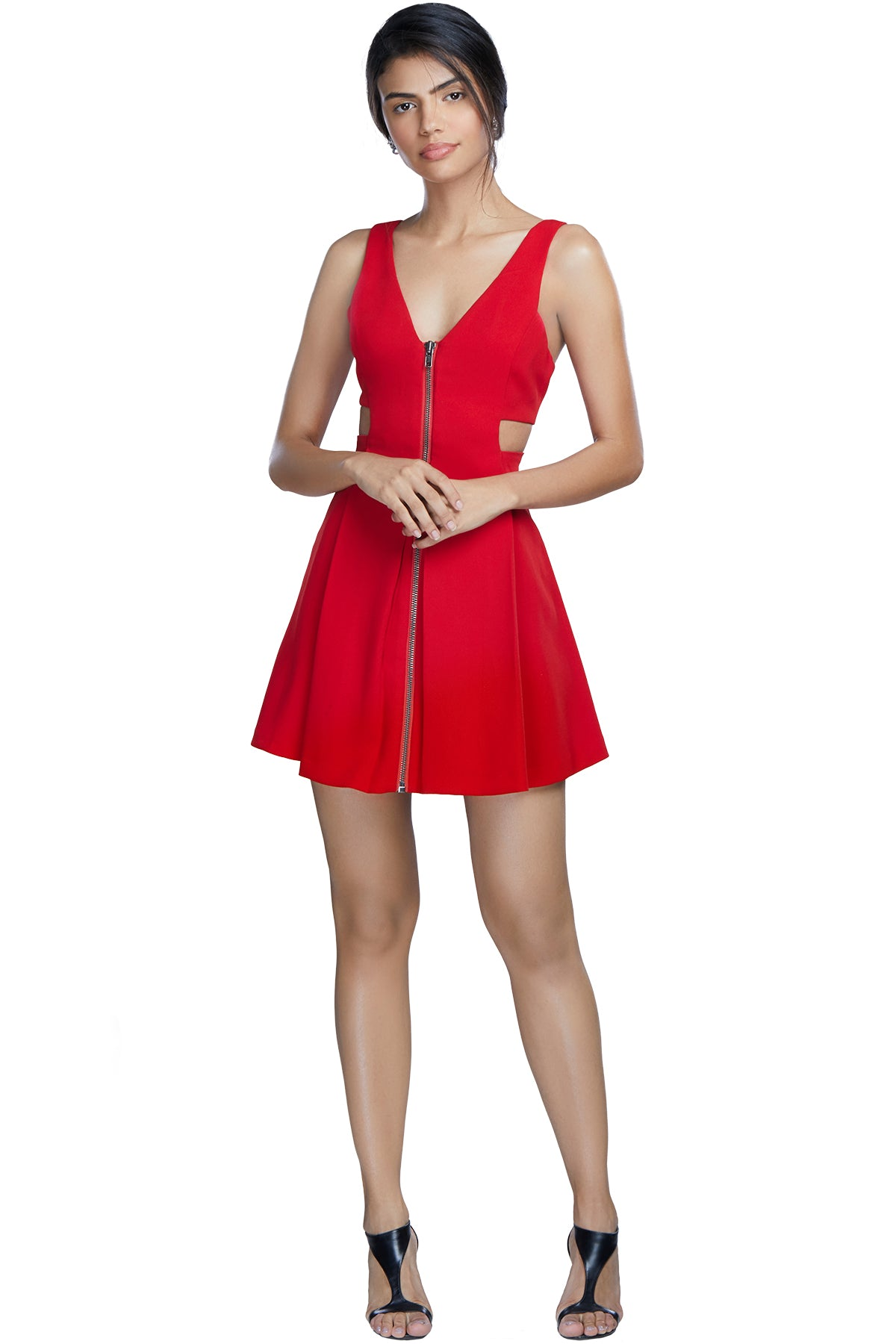 Go the spicy way for your next date night in this sexy cut-out mini dress with a low neck and front zip.