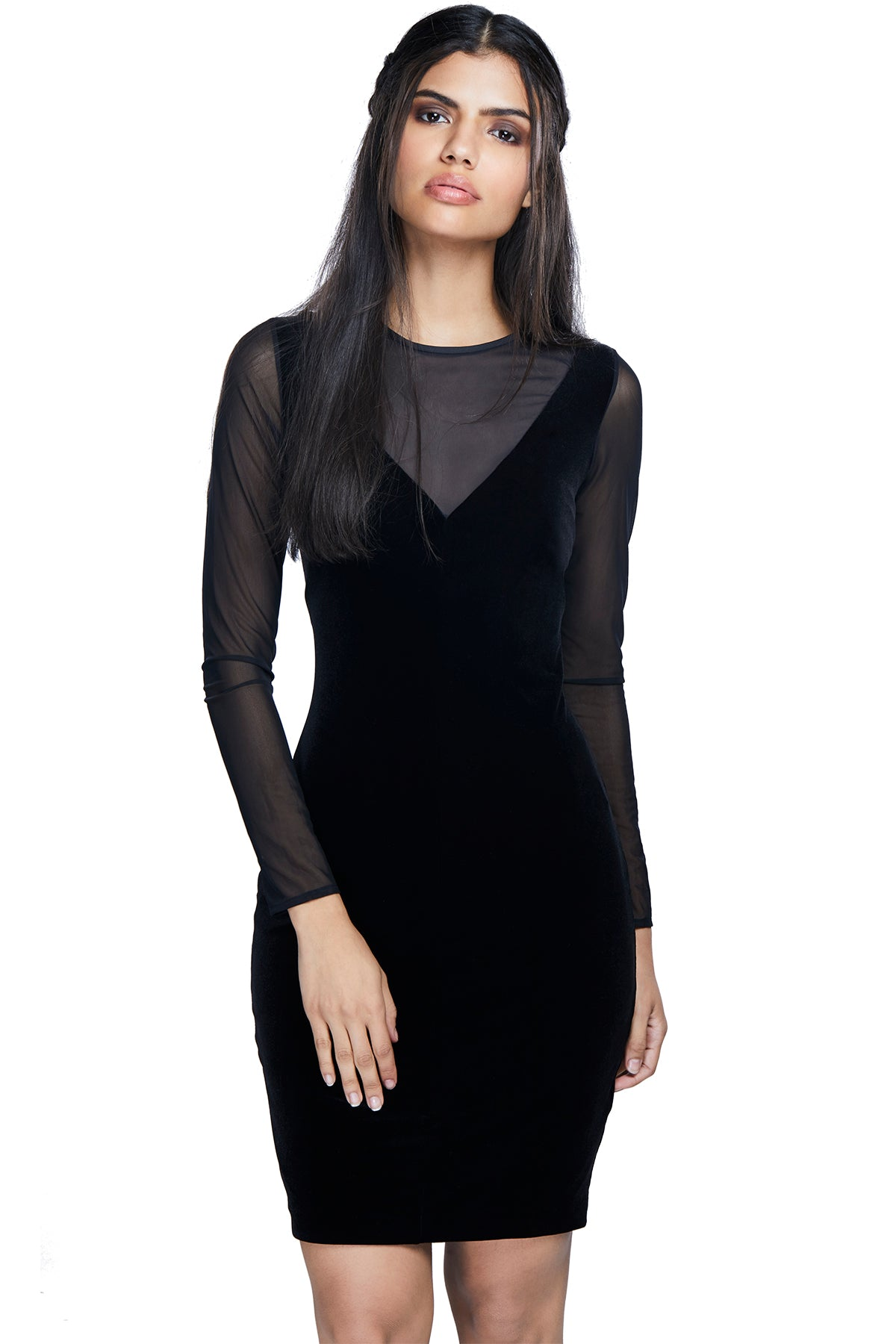 Take the plunge in this lush velvet dress with a v-neck and net at the neckline.