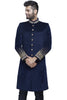 Royal blue velvet sherwani with gold buttons and embroidery detailings at collar and cuff. There are no pants with it.